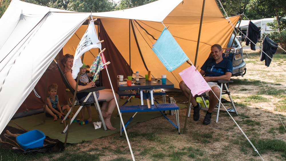 Dutch family in tent on summer holiday at Horsens City Camping